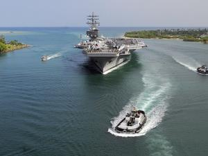 Aircraft Carrier USS Ronald Reagan Transits Pearl Harbor Into Hawaii by Stocktrek Images