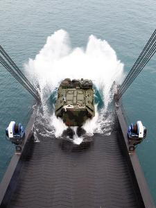 Amphibious Assault Vehicles Disembark from USNS 1st LT Jack Lummus by Stocktrek Images