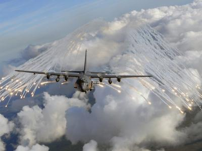 An AC-130U Gunship Jettisons Flares Over Florida