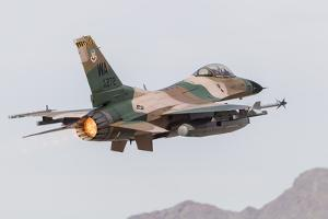An Aggressor F-16C Fighting Falcon of the U.S. Air Force by Stocktrek Images