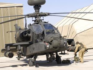 An Apache Helicopter at Camp Bastion, Afghanistan by Stocktrek Images