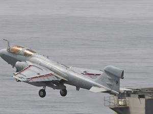 An EA-6B Prowler Lifts Off from the Flight Deck of USS Harry S. Truman by Stocktrek Images