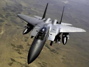 An F-15E Strike Eagle Aircraft in Flight Over Afghanistan by Stocktrek Images