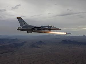 An F-16 Fighting Falcon Fires An AGM-65 Maverick Missile by Stocktrek Images