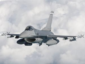 An F-16 from the Colorado Air National Guard in Flight over Brazil by Stocktrek Images
