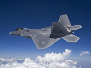 An F-22 Raptor Flies Around Southern New Mexico by Stocktrek Images