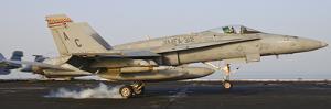 An F/A-18 Hornet Lands Aboard USS Harry S. Truman by Stocktrek Images