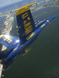 An F/A-18 Hornet of the Blue Angels Over Pensacola Beach, Florida by Stocktrek Images