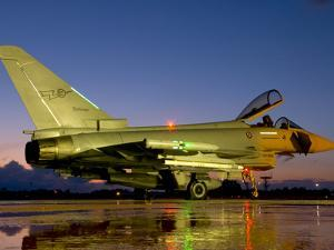 An Italian Air Force Eurofighter Typhoon at Night on Decimomannu Air Base, Italy by Stocktrek Images