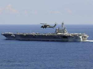 An MH-60S Seahawk Helicopter Flies over USS George H.W. Bush by Stocktrek Images