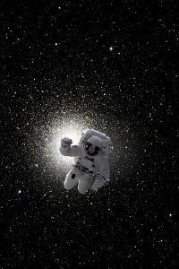 Astronaut Floating in Deep Space with Large Cluster Galaxy in Background by Stocktrek Images