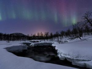 Aurora Borealis over Blafjellelva River in Troms County, Norway by Stocktrek Images