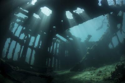 Bright Sunlight Pierces a Shallow World War Ii Shipwreck by Stocktrek Images