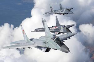 Bulgarian and Polish Air Force Mig-29S Aircraft Flying over Bulgaria by Stocktrek Images