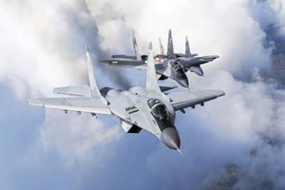 Bulgarian and Polish Air Force Mig-29S Planes Flying over Bulgaria by Stocktrek Images