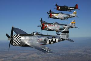 Formation of P-47 Thunderbolts Flying over Chino, California by Stocktrek Images