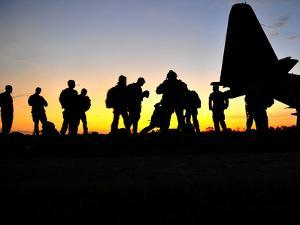 Green Berets Prepare to Board a KC-130 Aircraft by Stocktrek Images