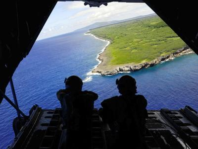 Loadmasters Look Out over Tumon Bay from a C-130 Hercules by Stocktrek Images