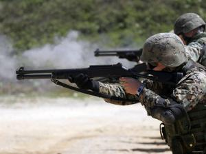 Marines Fire Joint Service Combat Shotguns by Stocktrek Images