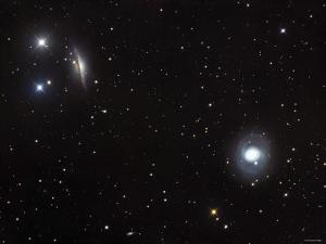 Messier 77 (NGC 1068), and NGC 1055 are Both Spiral Galaxies Located in the Constellation Cetus by Stocktrek Images