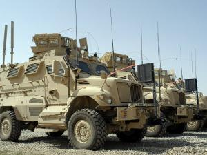 Mine Resistant Ambush Protected Vehicles Sit in the Parking Area at Joint Base Balad, Iraq by Stocktrek Images