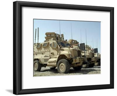 Mine Resistant Ambush Protected Vehicles Sit in the Parking Area at Joint Base Balad, Iraq