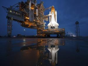 Night View of Space Shuttle Atlantis on the Launch Pad at Kennedy Space Center, Florida by Stocktrek Images