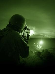 Night Vision View of a Special Operations Forces Soldier Firing His Weapon During Combat by Stocktrek Images
