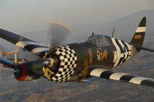 P-47 Thunderbolt Flying over Chino, California by Stocktrek Images