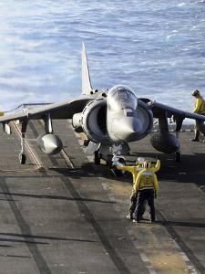 Sailors Prepare to Launch an AV-8B Harrier During Flight Operations Aboard USS Peleliu by Stocktrek Images