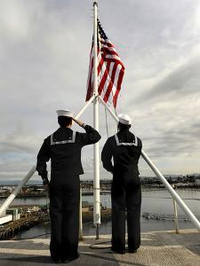 Sailors Raise the National Ensign Aboard USS Abraham Lincoln by Stocktrek Images