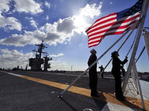 Sailors Shift the Colors Aboard the Aircraft Carrier USS Carl Vinson by Stocktrek Images