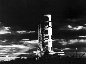 Searchlights Illuminate This Nighttime View of Apollo 17 Spacecraft On Its Launchpad by Stocktrek Images
