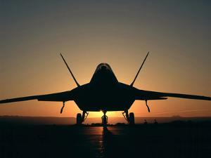 Silhouette of a F-22 Raptor by Stocktrek Images