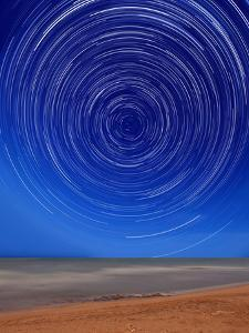 Star Trails around the South Celestial Pole at the Beach in Miramar, Argentina by Stocktrek Images