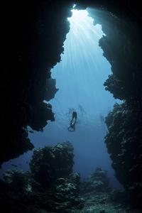 Sunlight Descends Underwater and into a Crevice on Palau's Barrier Reef by Stocktrek Images