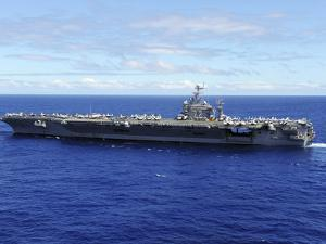The Aircraft Carrier USS Abraham Lincoln Transits across the Pacific Ocean by Stocktrek Images