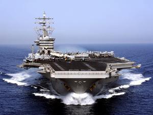 The Aircraft Carrier USS Dwight D. Eisenhower Transits the Arabian Sea by Stocktrek Images
