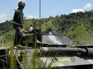 The Philippine Marine Battalion Landing Team Fire the Weapons System of a Light Armored Vehicle 300 by Stocktrek Images