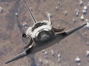 The Space Shuttle Discovery Approaches the International Space Station for Docking by Stocktrek Images
