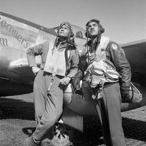 Tuskegee Airmen Posing with a P-51D Aircraft by Stocktrek Images