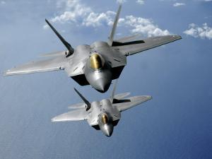 Two F-22 Raptors Fly over the Pacific Ocean by Stocktrek Images