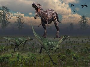 Two Lesothosaurus Dinosaurs Run Out of the Way of a T-Rex on a Rampage by Stocktrek Images