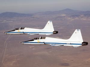 Two T-38A Mission Support Aircraft Fly in Tight Formation by Stocktrek Images