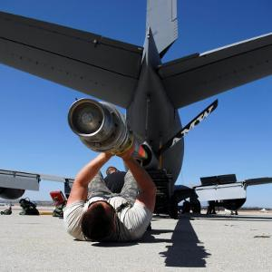 U.S. Air Force Airman Lifting the Boom of a KC-135 Stratotanker by Stocktrek Images