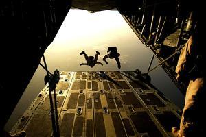 U.S. Air Force Pararescuemen Jump from an Hc-130 Aircraft Off the Coast of Djibouti by Stocktrek Images