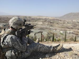 U.S Army Soldier Scans His Sector of Fire with His M14 Rifle in Afghanistan by Stocktrek Images