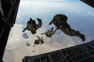 U.S. Pararescuemen and U.S. Marines Jump from a Hc-130 over Djibouti by Stocktrek Images