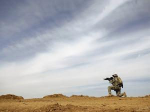 US Army Sergeant Provides Security During a Patrol of the Riyahd Village in Iraq by Stocktrek Images