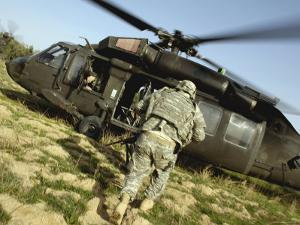 US Army Soldiers Board a UH-60 Black Hawk Helicopter by Stocktrek Images